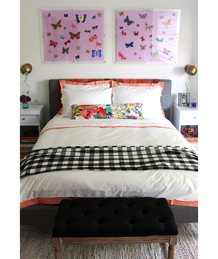 Girl's room with bright colors and metallic sconces