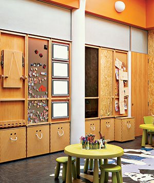 Storage closets made of particleboard in kids' play area