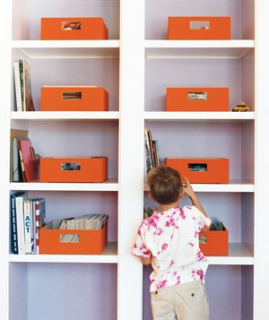 Boy placing items on a shelf
