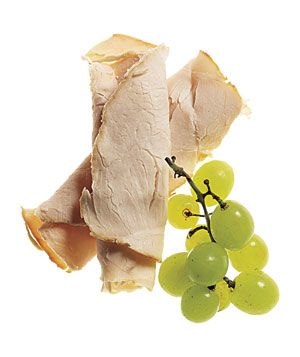 Sliced turkey with green grapes