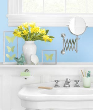 A retractable mirror is a practical solution on walls that won't allow for a conventional mirror.