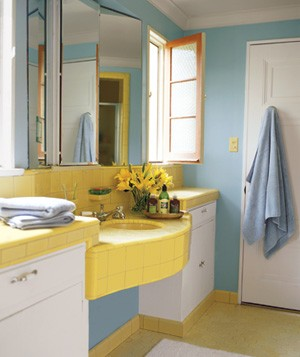 One lower-cost solution to old bathroom tiles: Blunt the behind-the-times feeling by painting the walls a complimentary color for a cheerful scheme.