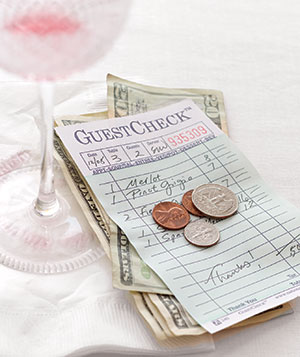 Restaurant bill with money