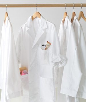 Doctor's White-coat with toy giraffe in pocket