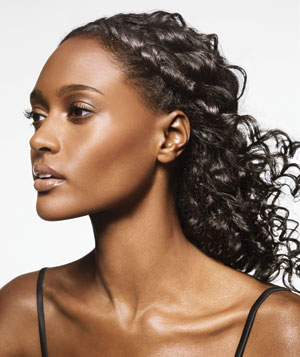 Model with twist in black curly hair