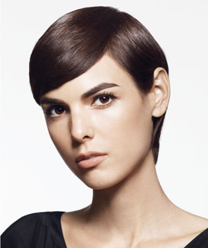 Model with side part in short brown hair