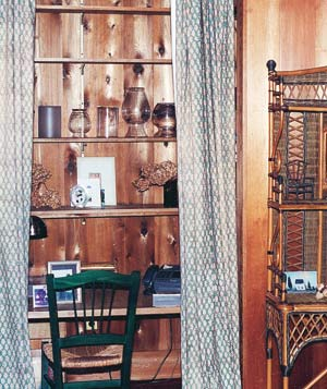 Wood paneled closet with shelves