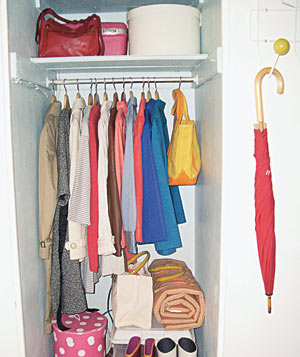 Entryway closet with coats and boots