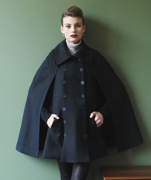 Model wearing a black wool cape