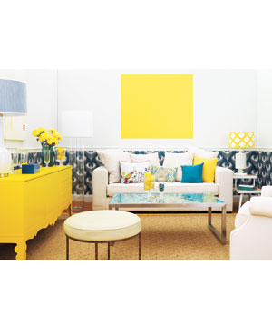 Living room with bright yellow and teal accessories