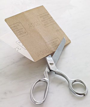Sandpaper sharpening scissors