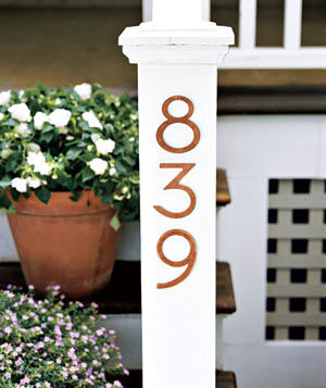White post with house number