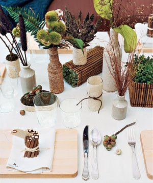 Table decorated with greenery and recycled items