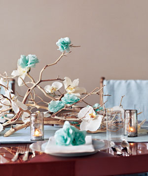 Table decorated with real and paper flowers