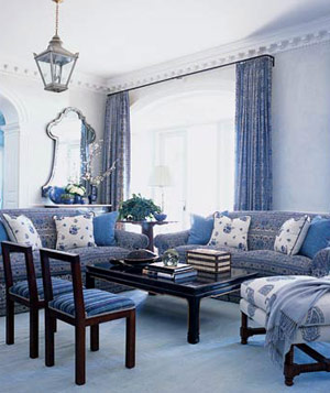 Livingroom with blue walls, floor, furniture, accet pillows and drapes