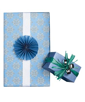 Gifts wrapped in blue paper with jingle bells and tiny handmade paper fan