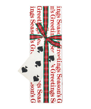 Gift wrapped in seasonal paper with a playing card