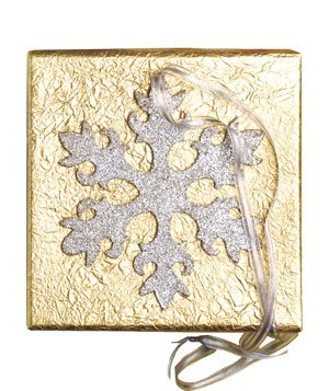 Gift wrapped in gold paper with silver snowflake ornament