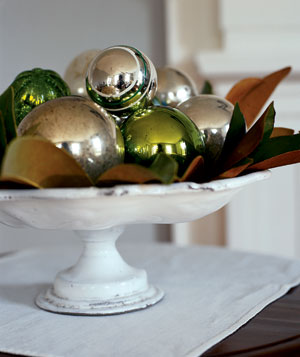 Antique ball ornaments on a cake stand platter