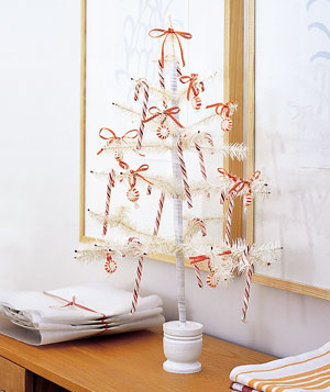Artificial white tree with candy canes and bows