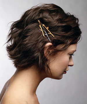 Model with bobby pins in her hair