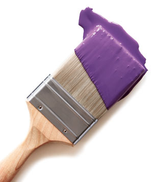 Purple paint on a paint brush