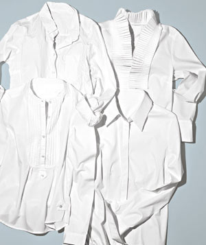Four white button up shirts