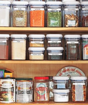 Spices and grains in an organized kitchen cupboard