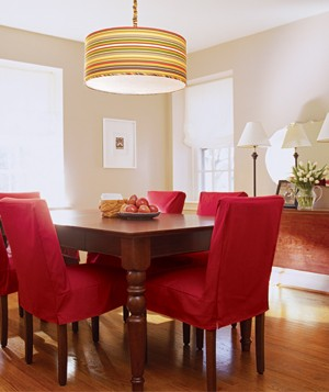 Dining Room With Red Chairs And A Striped Lamp