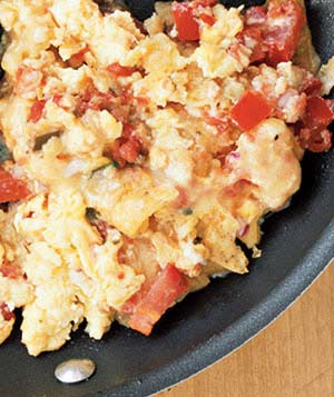Monterey Jack melts into scrambled eggs spiced with salsa.