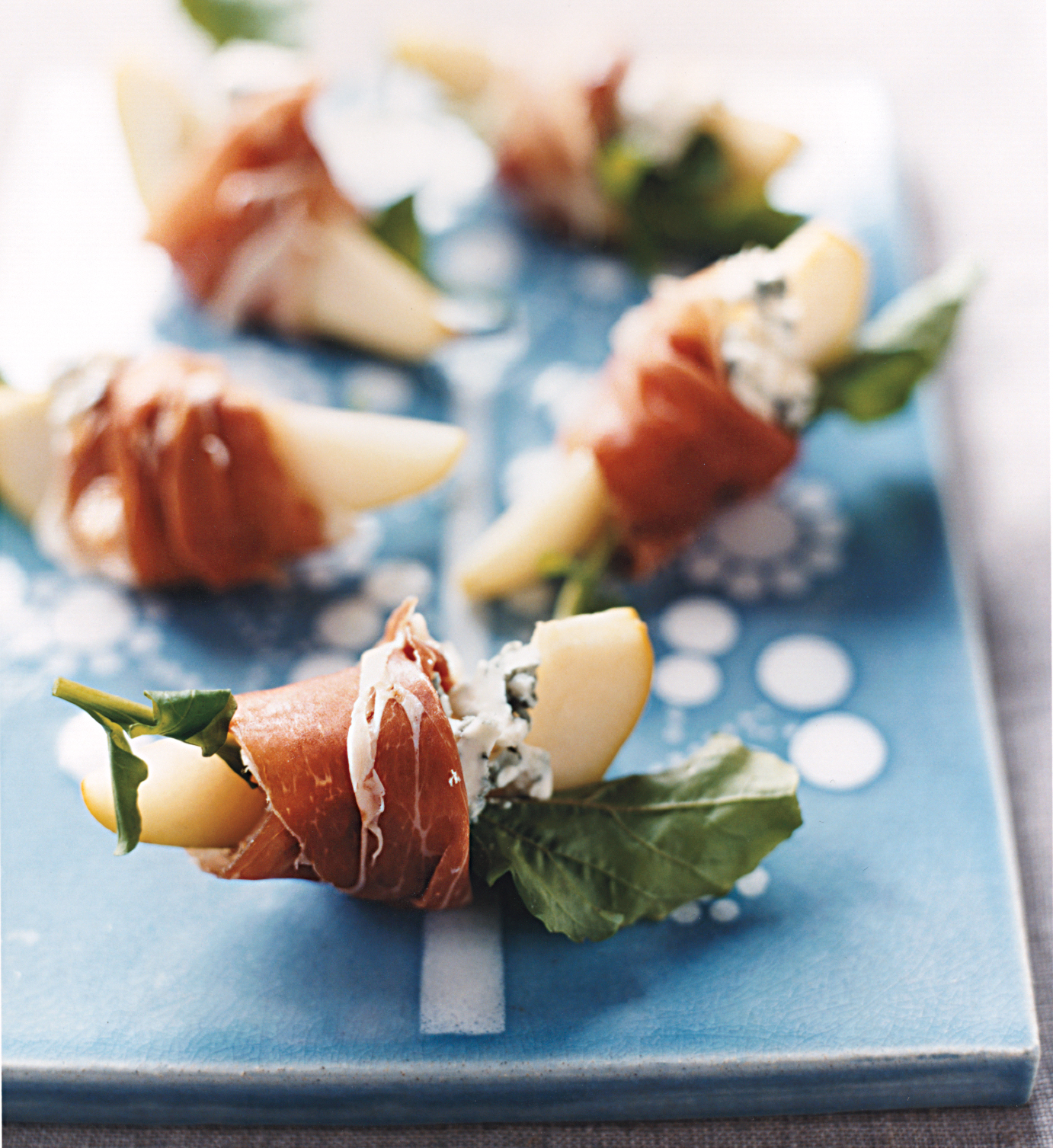 40 easy elegant recipes for christmas dinner real simple pears with blue cheese and prosciutto forumfinder Gallery
