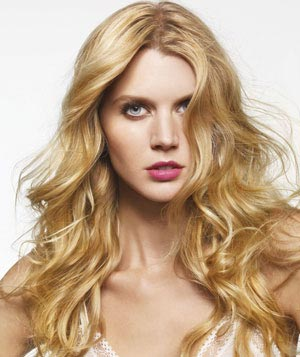 Model with long blonde wavy hair