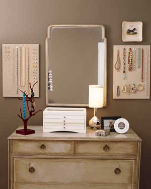 Pegboards holding jewelry beside dresser