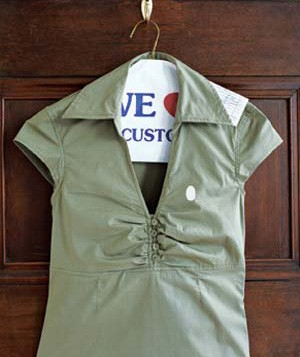 khaki dress on hanger