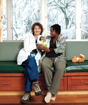 Portrait of Carol Ritter helping Haitian earthquake victims in a hospital