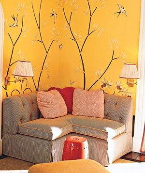 Yellow Branca designed the 1930s-inspired wallpaper in  a cozy liiving room with a banquette