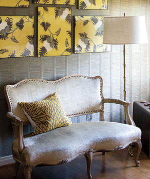 Cream settee in a room with yellow accessories