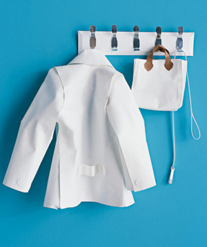 Paper construction of a jacket and bag on coat hanger by Matthew Sporzynski