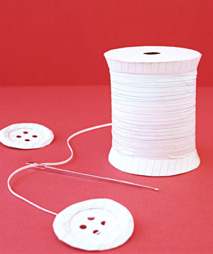 Paper construction of a spool of thread with buttons by Matthew Sporzynski