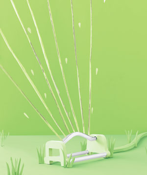 Paper construction of sprinkler in grass by Matthew Sporzynski