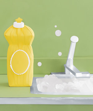 Paper construction of dishwasher liquid and suds in sink by Matthew Sporzynski
