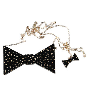 The Gold-Flecked Black Bow Tie Badge Pendant Necklace by Steven Shein