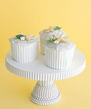 Paper construction of cupcakes on cake stand by Matthew Sporzynski