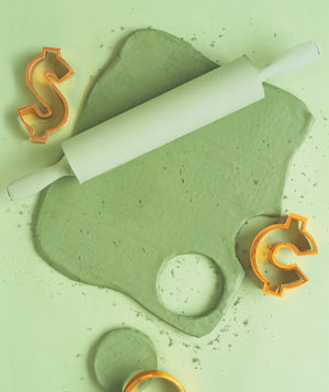 Paper construction of a cookie dough with rolling pin by Matthew Sporzynski