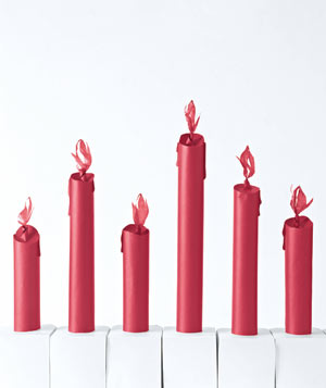 Paper construction of red candles by Matthew Sporzynski