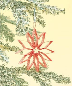 Paper construction of an ornament on tree by Matthew Sporzynski