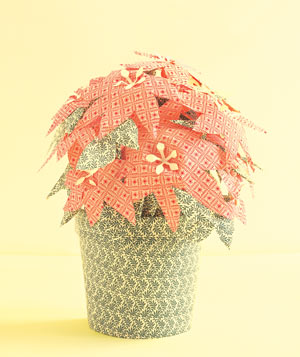 Paper construction of poinsettias in pot by Matthew Sporzynski
