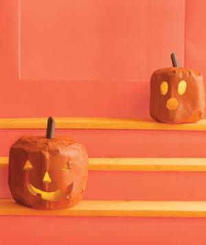 Paper construction of Jack-'O'-Lanterns on stairs by Matthew Sporzynski