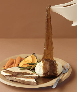 Paper construction of Thanksgiving food on dish with gravy by Matthew Sporzynski
