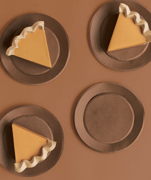 Paper construction of pumpkin pie on plates by Matthew Sporzynski